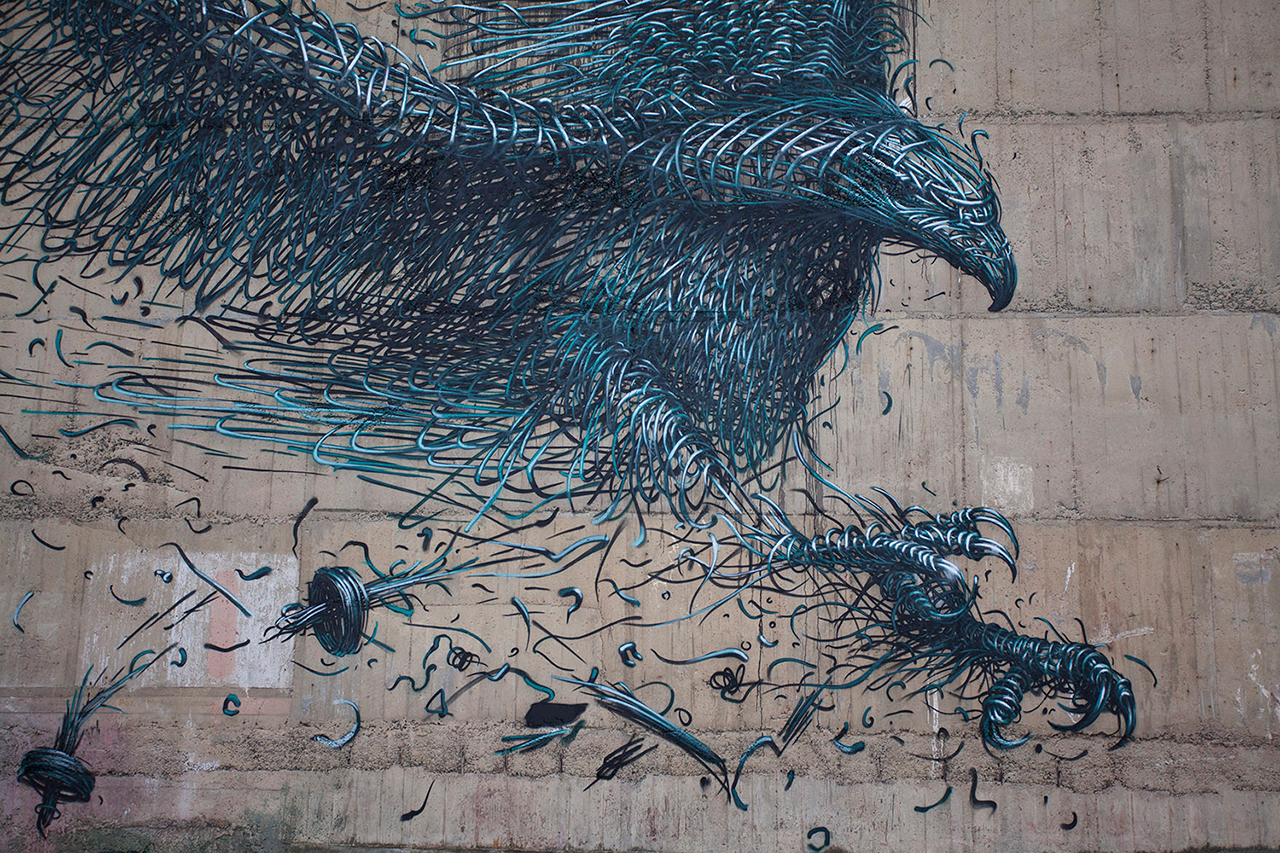 Daleast creates a massive defoliation mural in new for Eagle wall mural