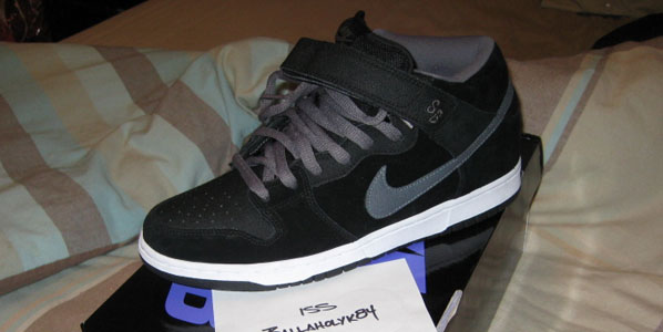 """sports shoes f28ad 690cd Heres a look at a recently released Nike Dunk Mid """"Griptape"""" SB. This  sneaker features a black colorway with graphite laces and a graphite swoosh."""