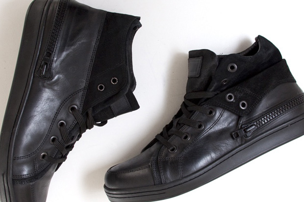 black leather sneakers. a lack leather upper with