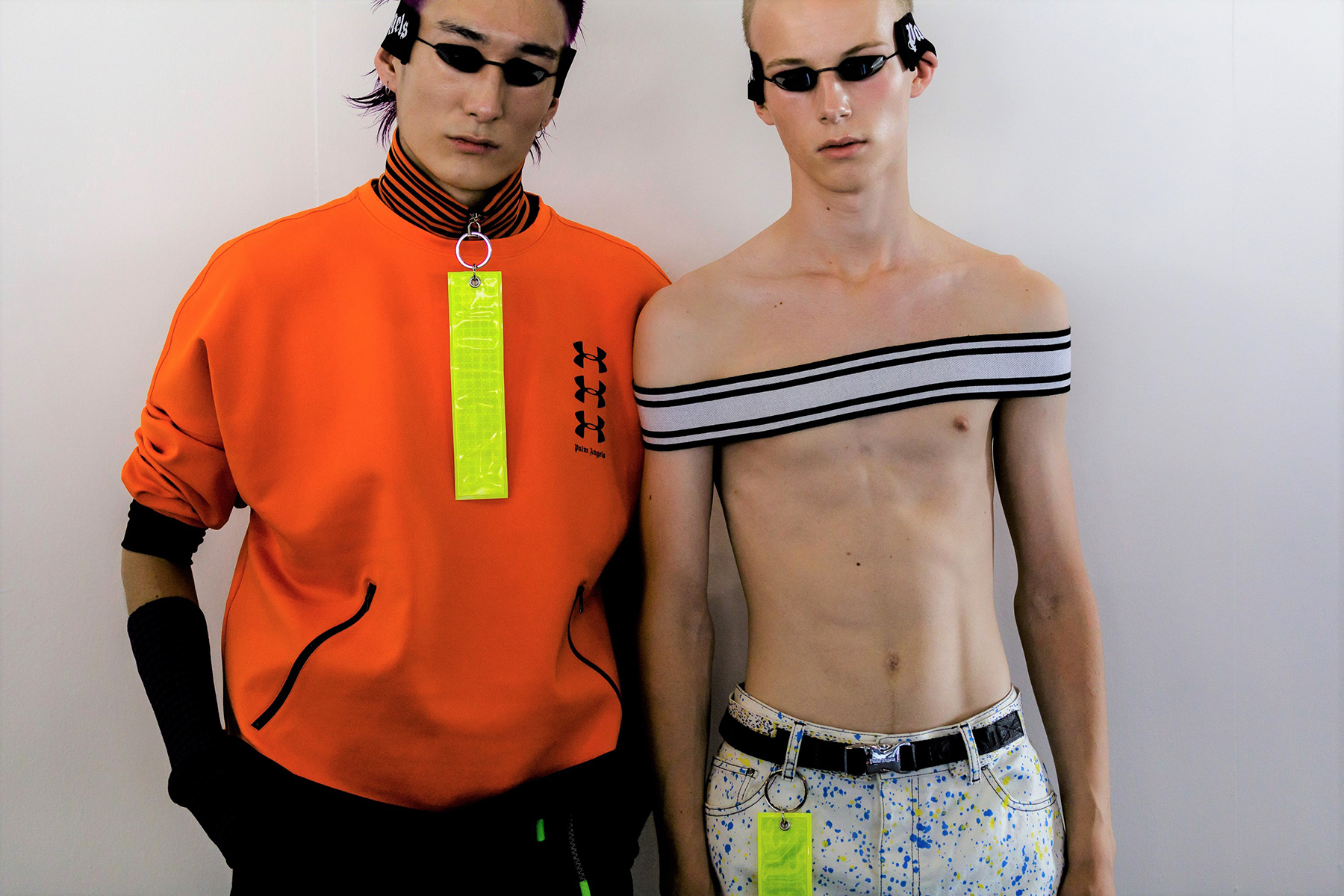 palm angels spring summer 2019 milan fashion week orange shirt yelllow badge tanning bed glasses goggles painted denim